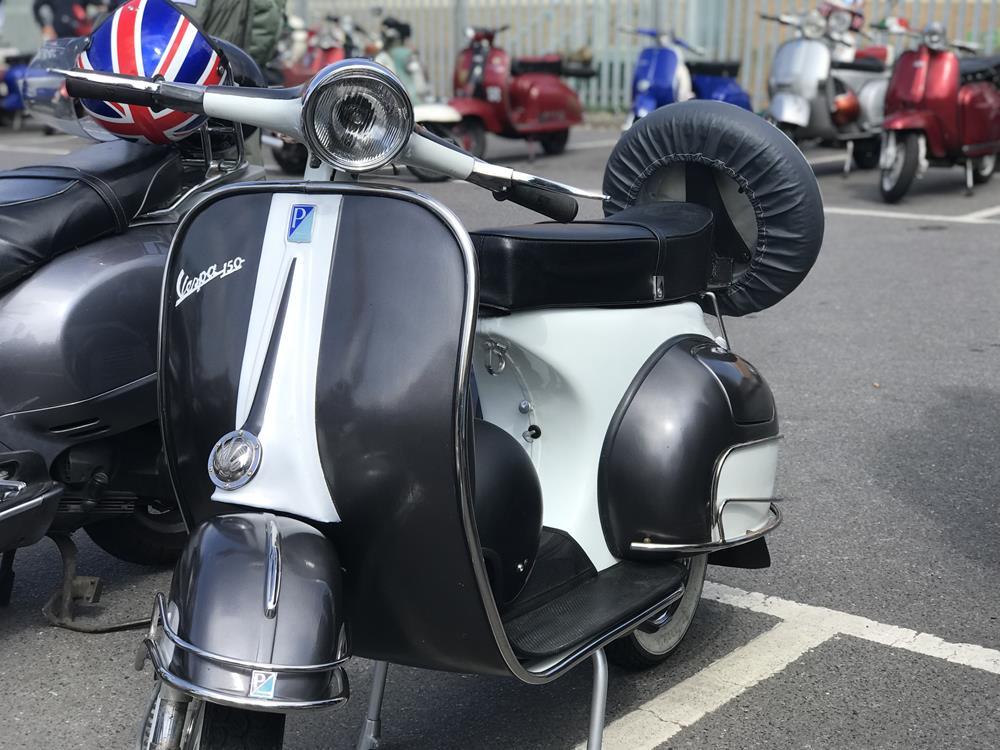 Silver and black vintage Vespa scooter