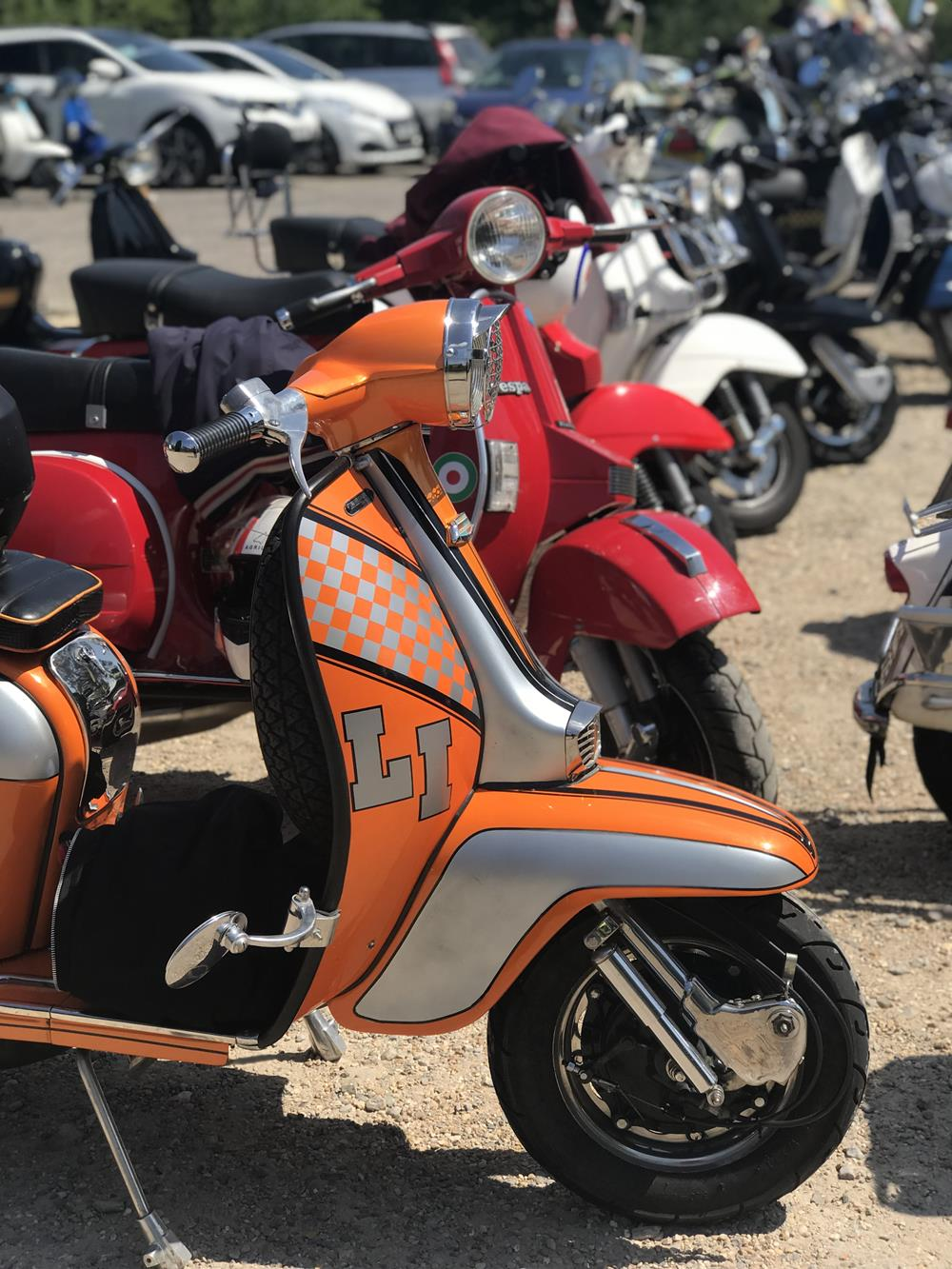 Orange Lambretta LI with other scooters in the background