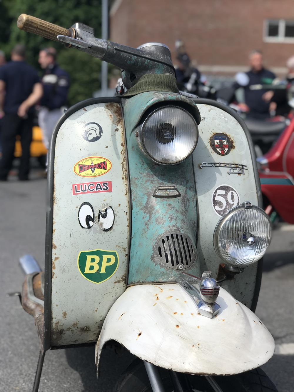 Rusty Series 1 Lambretta with stickers on the front