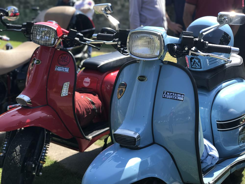 Sky blue and red Scomadi scooters at the Bulldog Run 2018