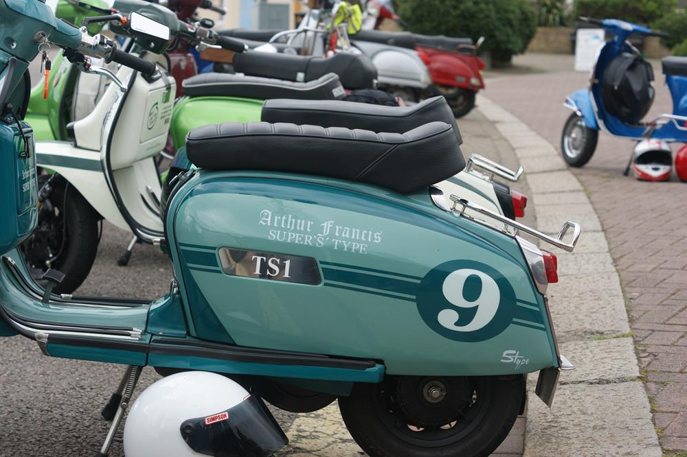 Row of scooters with a green Lambretta at the front