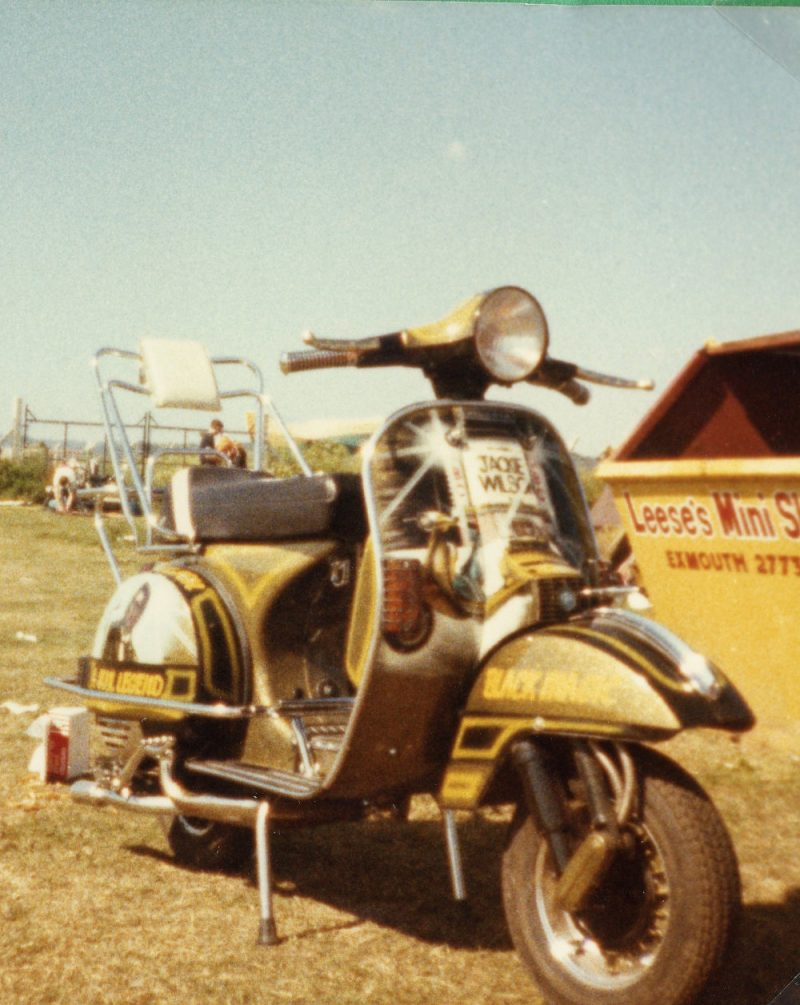 A Vespa P range with Jackie Wilson murals and black and yellow paintwork
