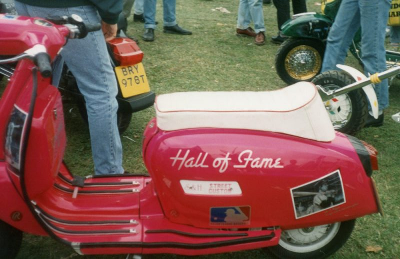 Pink Lambretta scooter with Hall Of Fame written on the side panel and a mural of a baseball player