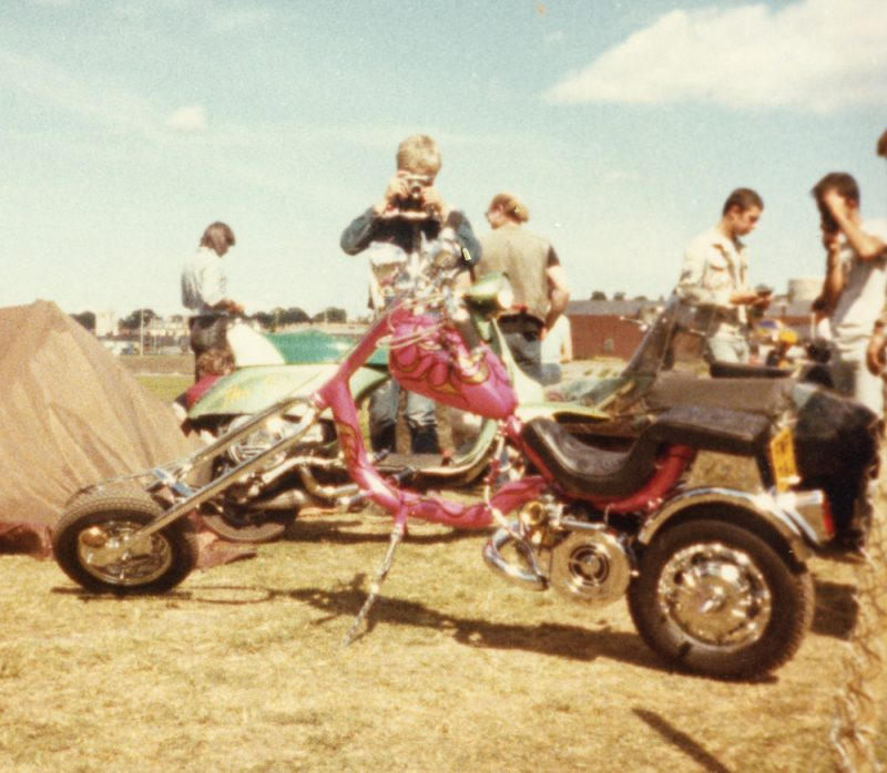 A lovely pink Lambretta chopper with black seat and lots of chrome