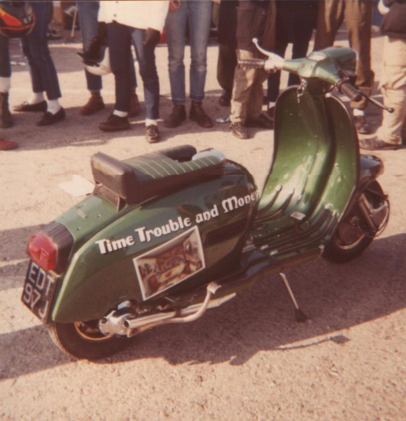 Time, trouble and money, a green Lambretta with racing seat