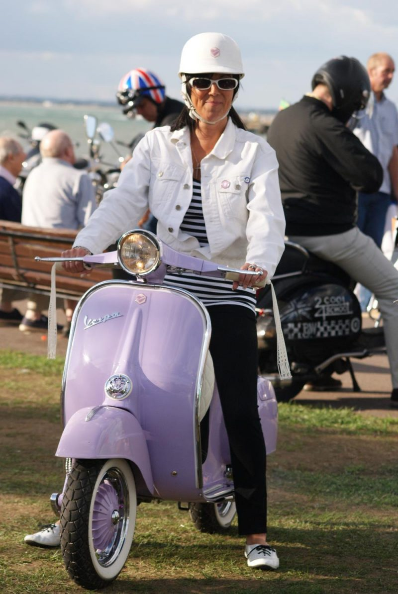 Lady sitting on a lilac vintage vespa smallframe