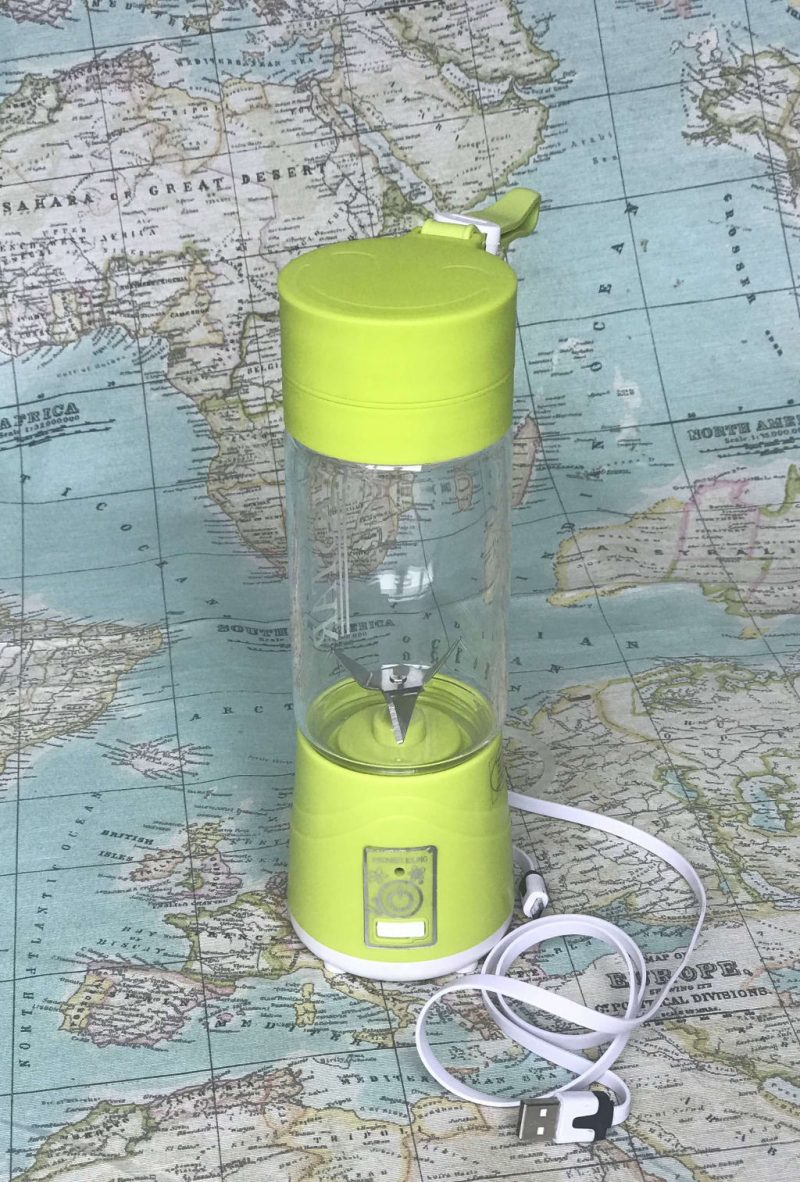 A green blender with USB charging cable